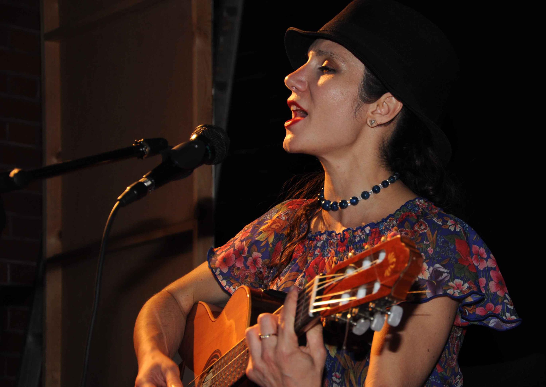 Corina singing live at Redding milonga_edited.jpg