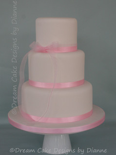 'Claire' ~ simply iced with a pretty pink ribbon and bow