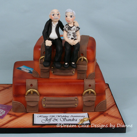 50th ANNIVERSARY ~ stacked suitcases with personalised models of the couple