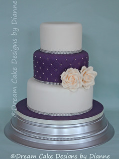 'KATHERINE' ~ 3 tier cake with a contrasting quilted centre tier with diamante trim and 2 cream roses