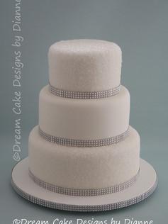'KIRSTY' ~ All white wedding cake with sugar sparkles and diamante trim