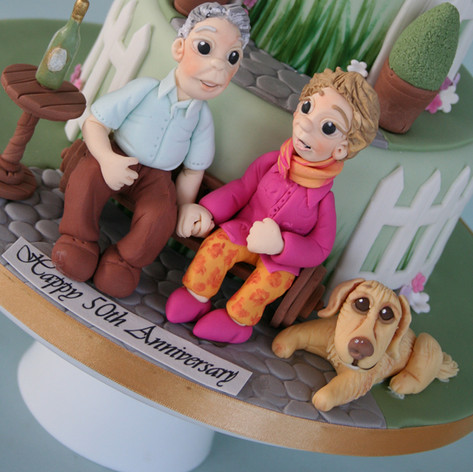 50th WEDDING ANNIVERSARY ~ golden anniversary cake with a garden themed design personalised models of the couple