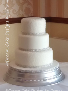 'KIRSTY' ~ all set up at the Kings Croft Hotel. All white wedding cake with sugar sparkles and diamante trim