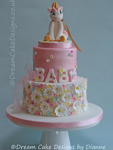 BABY SHOWER ~ 2 tier cake with a Unicorn cake topper and a pretty floral design