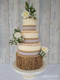 SEMI NAKED CAKE WITH RUSTIC LOG BASE CAKE