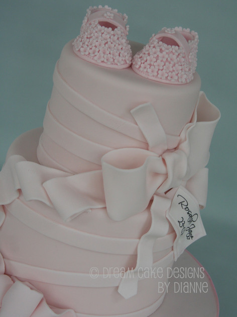 'ROSALIE JANE' ~ NAMING CEREMONY cake with pretty blossom bootees and beautiful 'floppy' bow