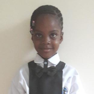 Beauty in school uniform cropped.jpg