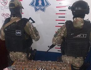 Arma y drogas aseguradas.jpeg