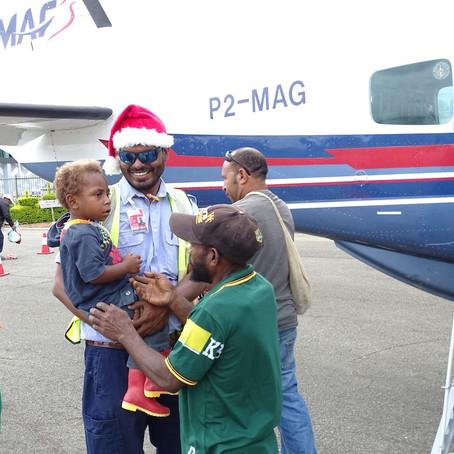 Santa Pilots Bring Christmas Cheer to Remote PNG Communities