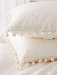 white pom fringe pillowcases.jpg