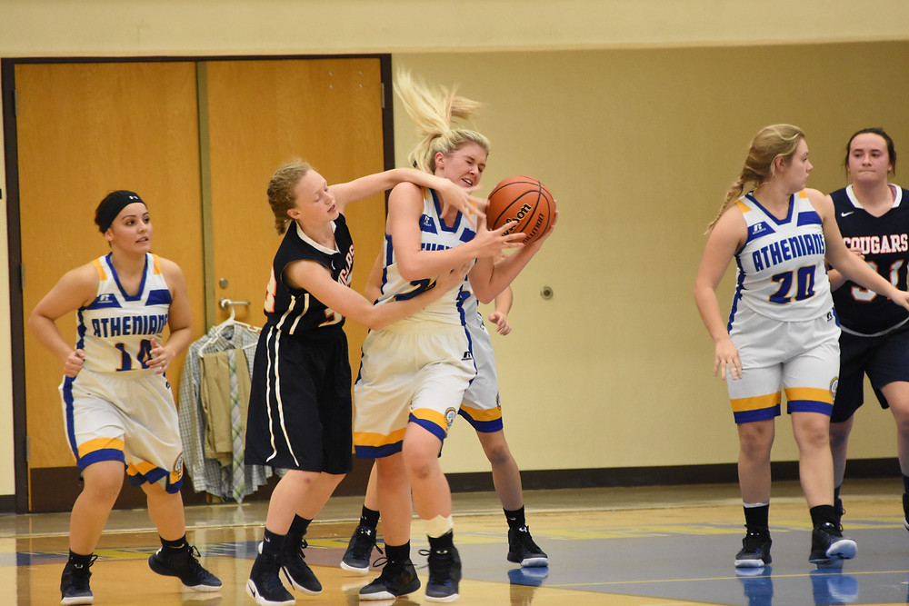 Zoe Walbert grabs a big rebound for the Athenians.