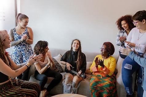 Canva - Women Get Together.jpg