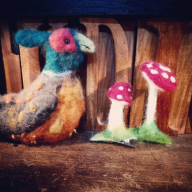 Needle felted pheasant and toadstools.