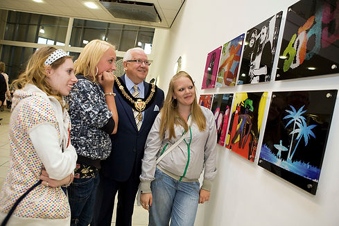 Young people showing their work to their local mayor.