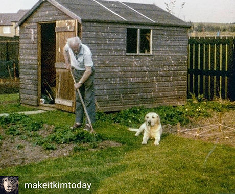 Kim's grandad stood in front of his shed with his golden labrador Major.