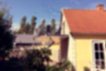 Altanen fra Vestværelset med blå himmel og solskin