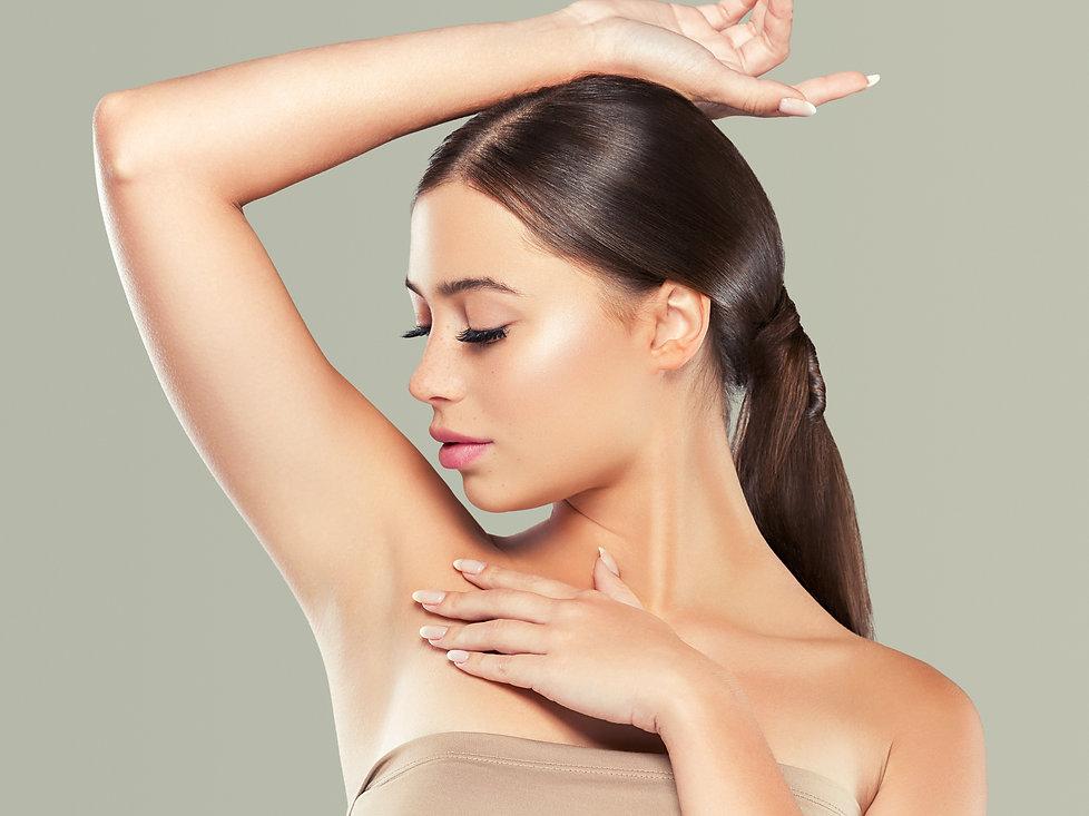 Armpit woman hand up epilation concept.j