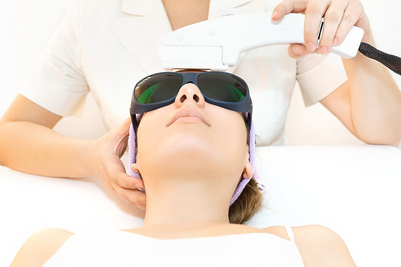 Young woman receiving laser therapy.jpg
