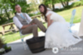 Krystal washes Ian's feet during their May 2016 wedding at Colt State Park in Bristol, Rhode Island.