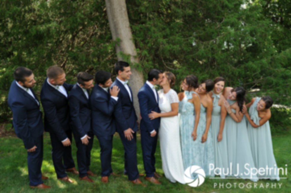 Jennifer and Bruce pose for a formal photo with their wedding party prior to their August 2017 wedding ceremony at The Inn at Mystic in Mystic, Connecticut.