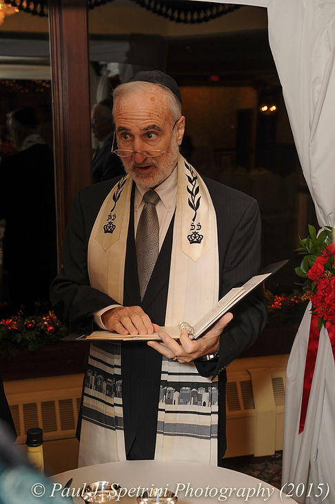 The rabbi at Cathy and Ron's December 2015 wedding at Quidnessett Country Club in North Kingstown, Rhode Island.