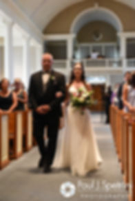 Alyssa and her father walk down the aisle during her August 2016 wedding ceremony at Holy Name Church in Fall River, Massachusetts.