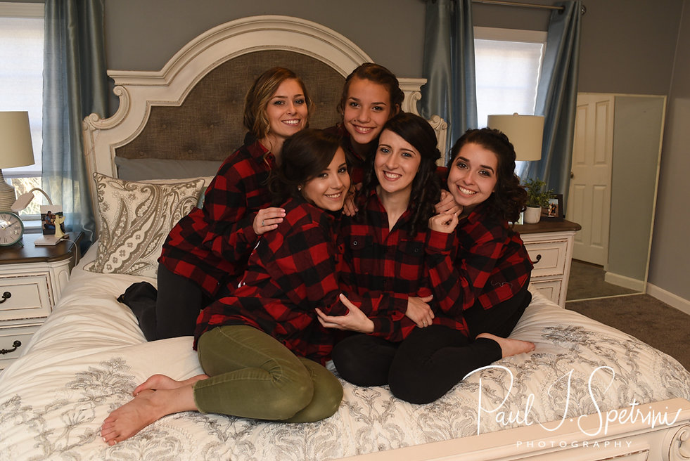 Stacey poses for a photo with her bridesmaids during her bridal prep session at in Attleboro, Massachusetts.