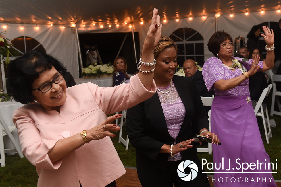Guests dance during Forrester and Lisajean's October 2016 wedding reception in Charlestown, Rhode Island.