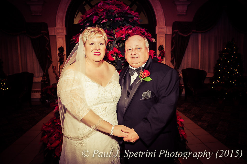 Ron and Cathy smile for a photo during their December 2015 Rhode Island wedding at Quidnessett Country Club in North Kingstown, RI.