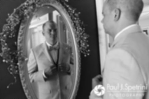 Kelly looks in a mirror prior to his August 2017 wedding ceremony in Warwick, Rhode Island.