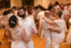 Mike & Selah dance with guests during their August 2018 wedding reception at The Rotunda Ballroom at Easton's Beach in Newport, Rhode Island.