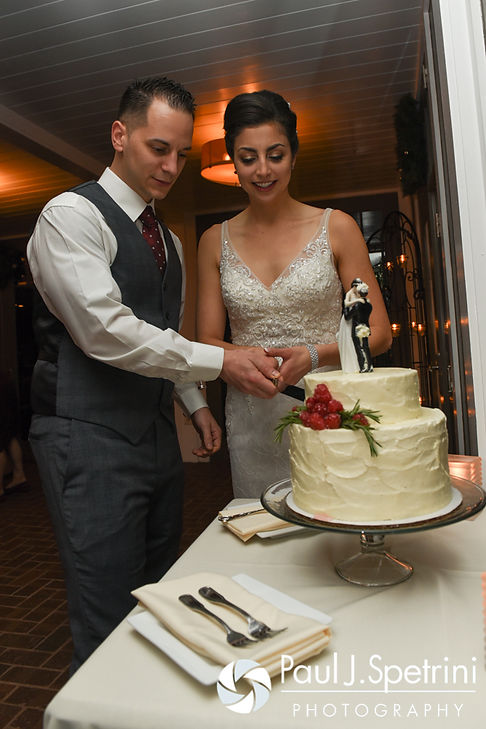 Gina and David cut their wedding cake during their December 2016 wedding reception at the Waterman Grille in Providence, Rhode Island.