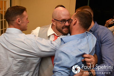 Eric hugs friends during his May 2016 wedding at Hillside Country Club in Rehoboth, Massachusetts.