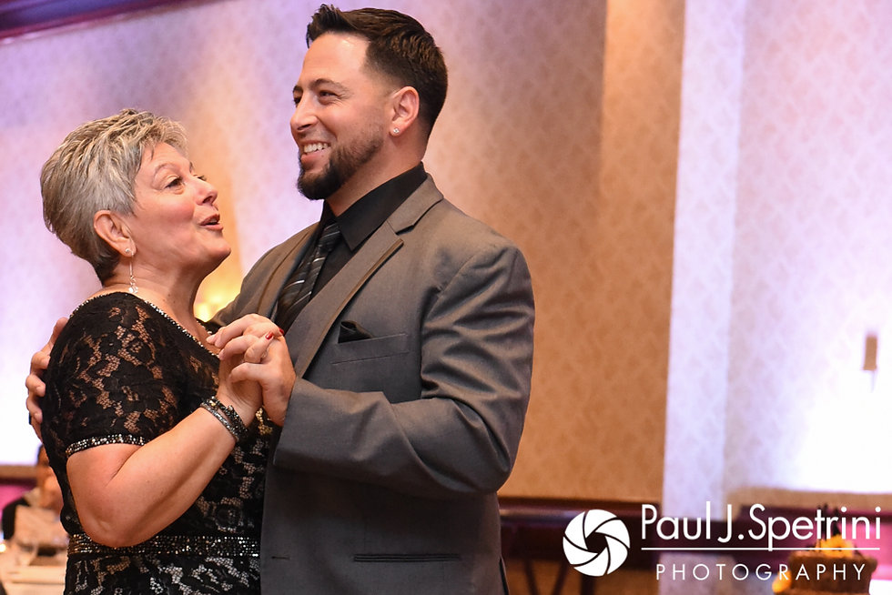 Dallas and his mother dance during his September 2017 wedding reception at the Crowne Plaza Hotel in Warwick, Rhode Island.