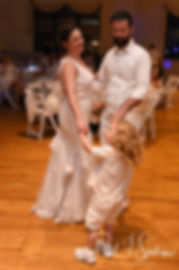 Mike & Selah dance with their ringbearer during their August 2018 wedding reception at The Rotunda Ballroom at Easton's Beach in Newport, Rhode Island.