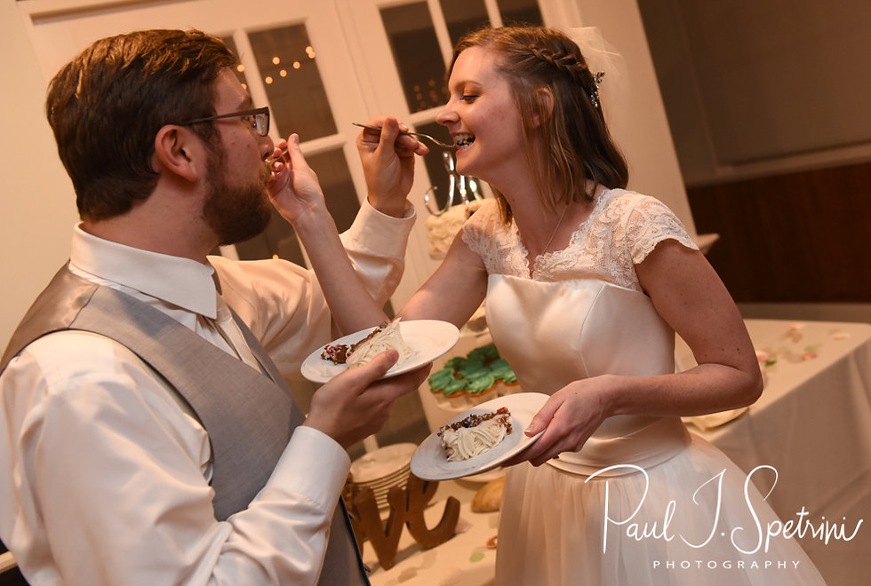 Amber & Justin feed each other their wedding cake during their June 2018 wedding reception at North Beach Clubhouse in Narragansett, Rhode Island.
