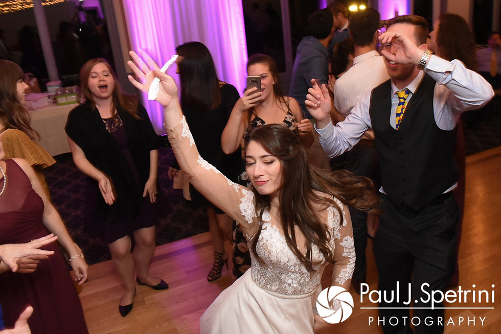 Guests dance during Keiran and Jessica's October 2017 wedding reception at Crystal Lake Golf Club in Mapleville, Rhode Island.
