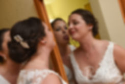 Selah looks into the mirror prior to her August 2018 wedding ceremony at The Rotunda Ballroom at Easton's Beach in Newport, Rhode Island.