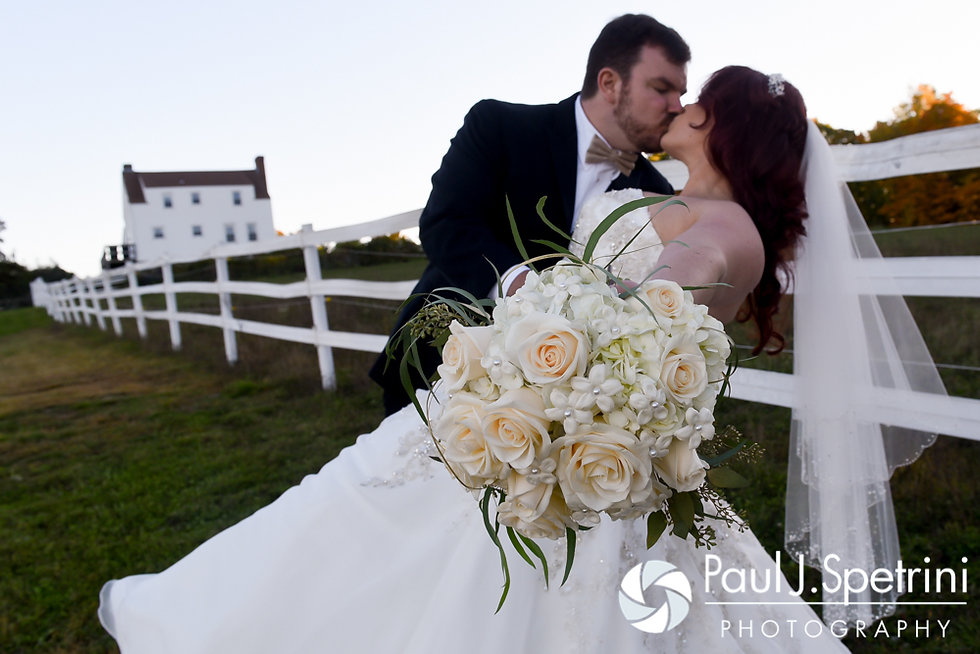 JD and Brooke kiss during a formal photo following their October 2016 wedding ceremony at The Farm at SummitWynds in Jefferson, Massachusetts.