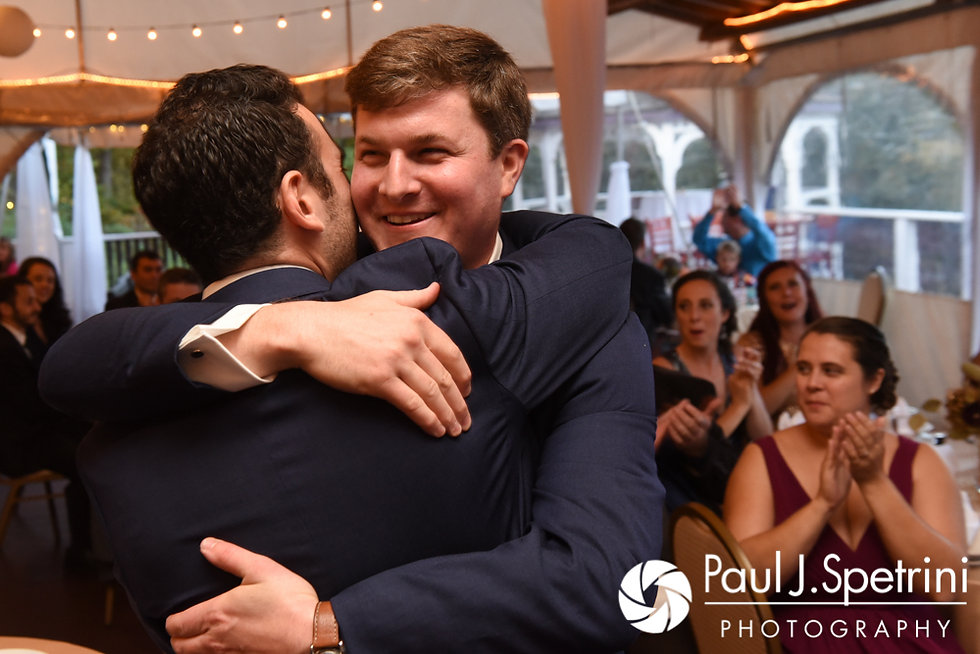 Mike hugs his best man during his October 2017 wedding reception at Castle Manor Inn in Gloucester, Massachusetts.