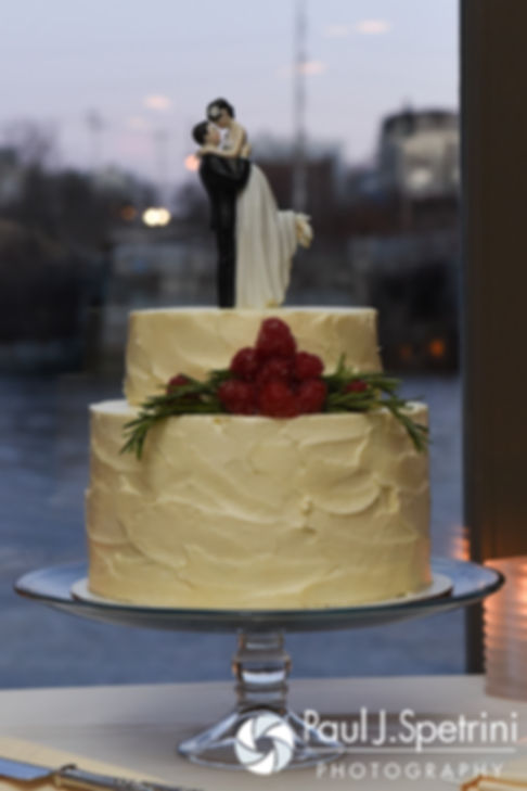 A look at the wedding cake, on display during Gina and David's December 2016 wedding ceremony at the Waterman Grille in Providence, Rhode Island.