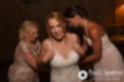 Kim has her wedding dress zipped up prior to her August 2016 wedding at Whispering Pines Conference Center in West Greenwich, Rhode Island.