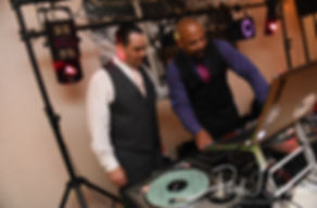 Jacob talks to the DJ during his June 2018 wedding reception at Foster Country Club in Foster, Rhode Island.
