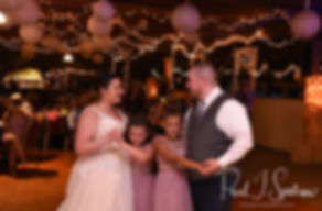 Adam and Ashley dance with their children during their September 2018 wedding reception at Stepping Stone Ranch in West Greenwich, Rhode Island.
