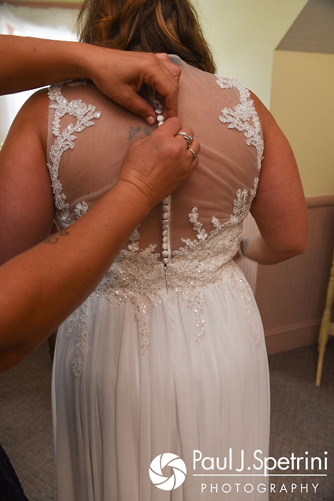 Toni has her dress zipped up prior to her August 2017 wedding ceremony at Crystal Lake Golf Club in Mapleville, Rhode Island.
