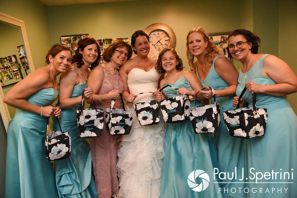 Kelly and her bridesmaids pose for a photo prior to her November 2016 wedding ceremony at the Bay Pointe Club in Buzzards Bay, Massachusetts.