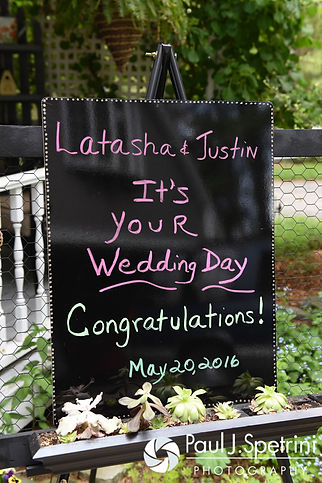 A sign is on display congratulating Latasha and Justin on their May 2016 wedding at Country Gardens in Rehoboth, Massachusetts.