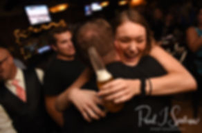 Guests hug during Patrick and Courtney's September 2018 wedding afterparty at Pub on Park in Cranston, Rhode Island.