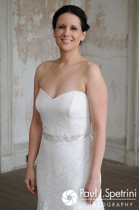 Morgan smiles for a photo before her April wedding ceremony at the Fort Adams Trust in Newport, Rhode Island.