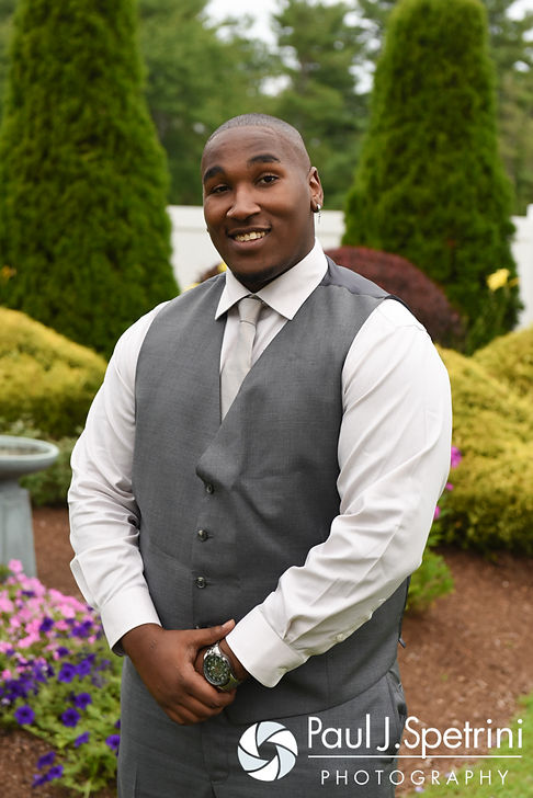 Warren smiles for a formal photo prior to his August 2016 wedding reception at the Villa at Riddler Country Club in East Bridgewater, Massachusetts.